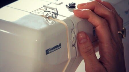 Adjusting the tension on serger.