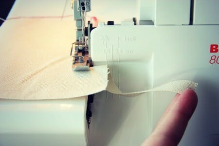 Serger cuts the fabric during the sewing process